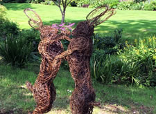 My RHS Chelsea Flower Show bronze wire sculpture 'Mad March Hares' installed today in a beautiful garden in Worcestershire.